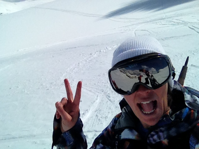 Tammy stoked on an awesome day of springtime snowboarding!