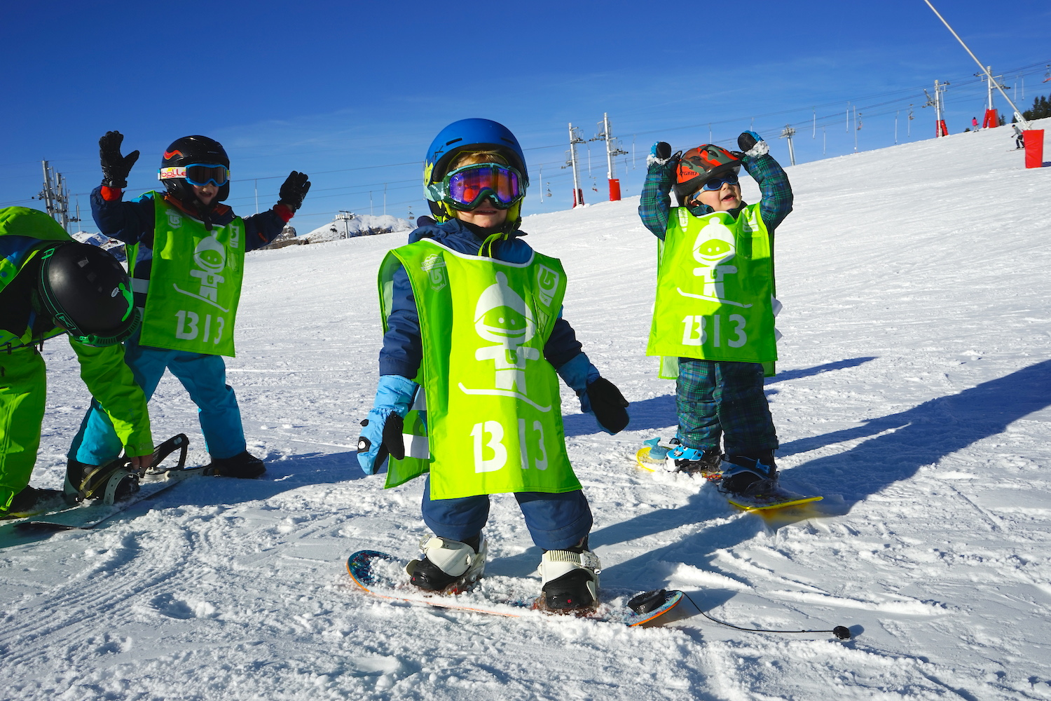 teaching children to snowboard