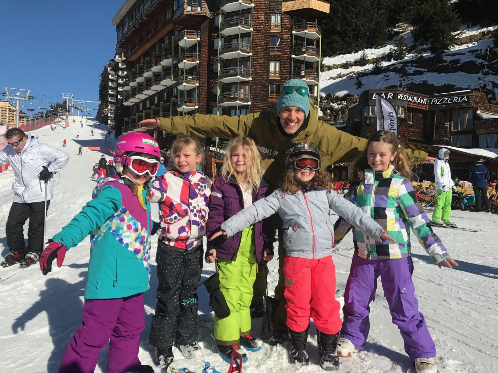 Kids snowboarding lessons in the alps