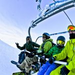 family snowboard chairlift