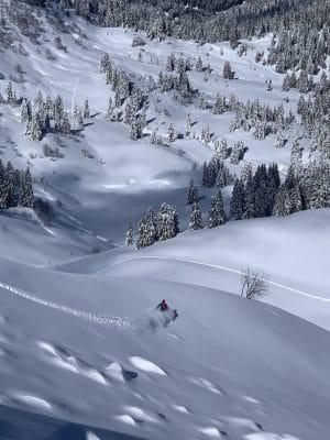 snowboarder riding powder france